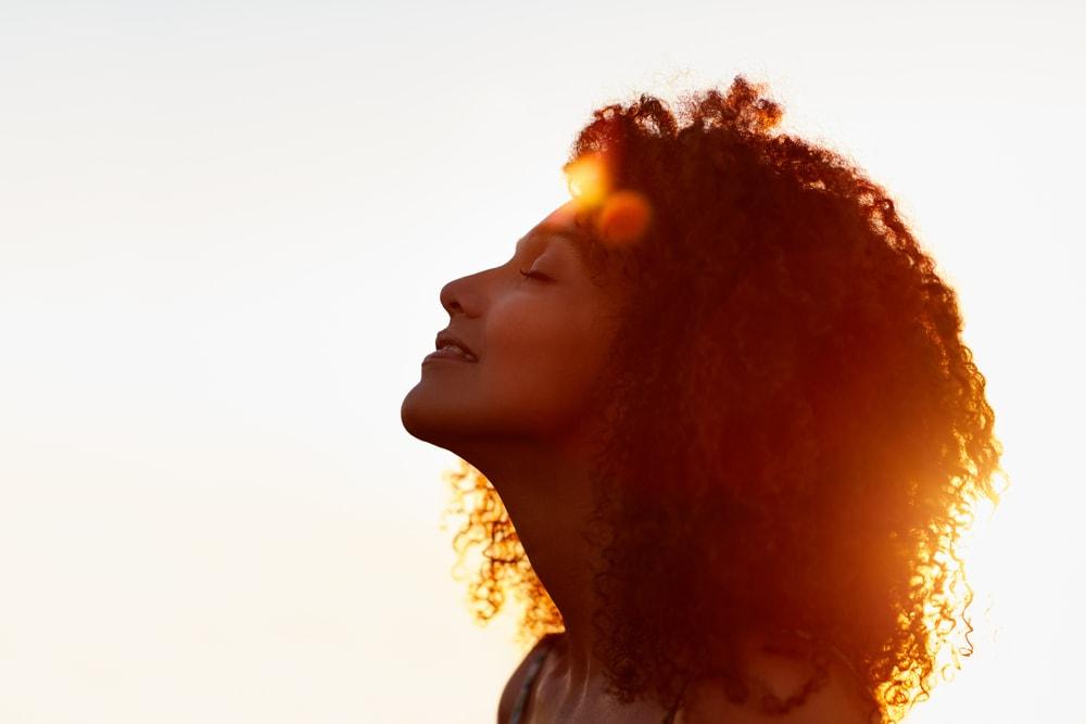 black woman enjoying the sun